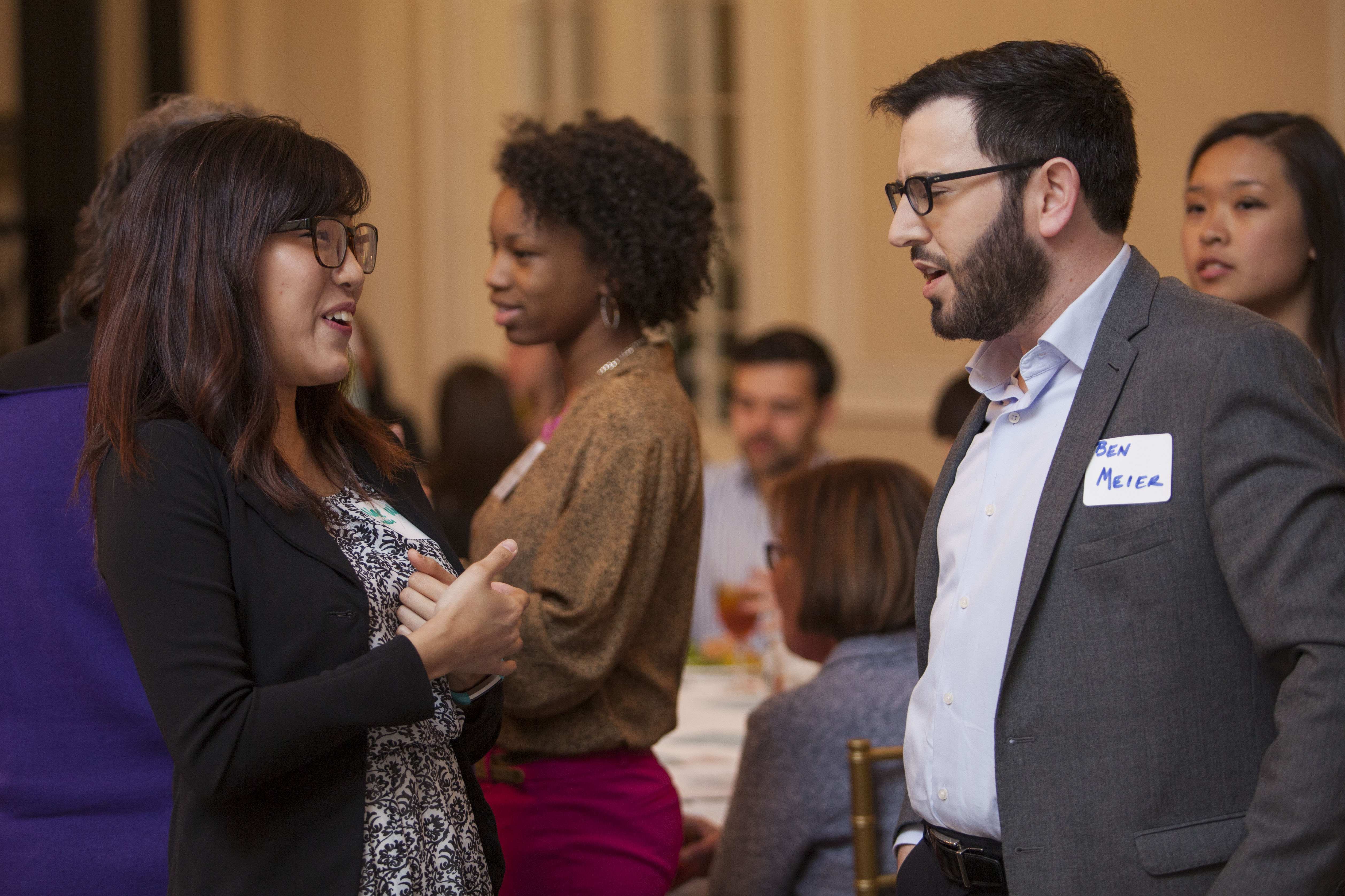 Students share ideas at an informal networking event.