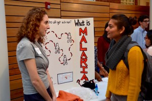 A student shares information on the spread of malaria at the Gillings School's annual Practicum Day.