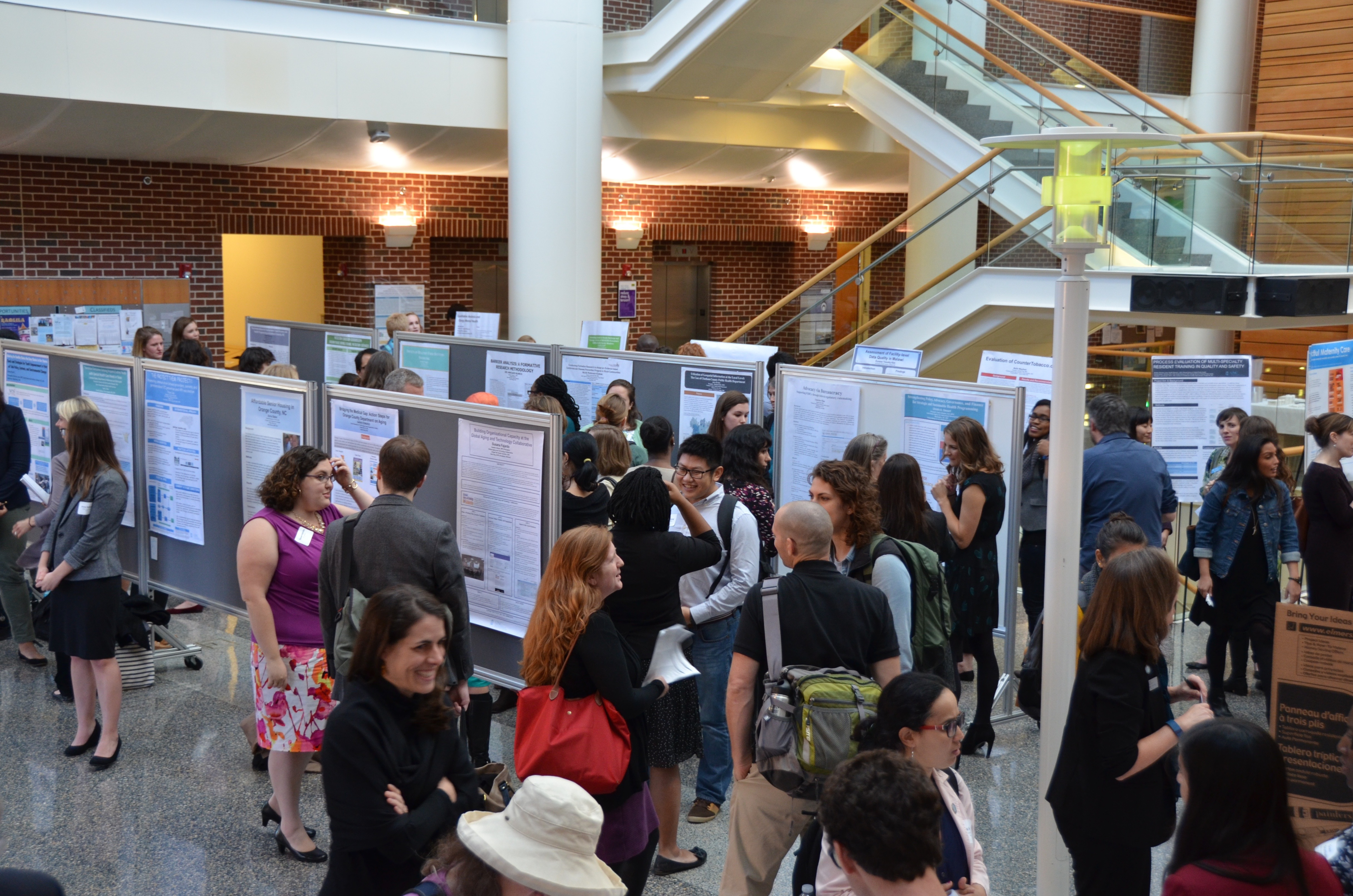 Practicum Day fills Armfield Atrium with posters sharing original research.