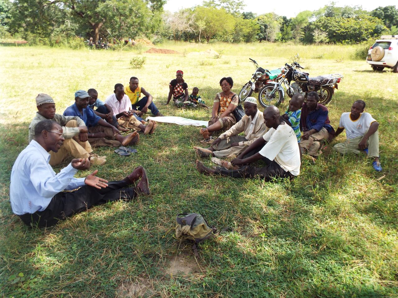 Villagers in Burkina Faso hold a community meeting to organize the construction of a new well.