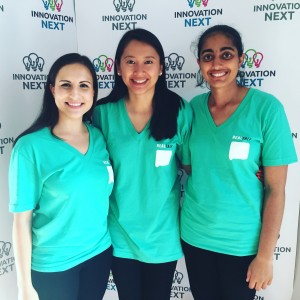 "(L-R) Cristina Leos and Liz Chen, doctoral students in health behavior at the Gillings School, and Vichi Jagannathan, an MBA candidate at Yale, posed after pitching ""Real Talk,"" the award-winning mobile app they designed."