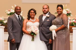 On her wedding day, Deanna posed with (from left to right) Dennis Tabron, her father, Jarrett Hedgepeth, her husband, and Sherry Tabron, her mother.