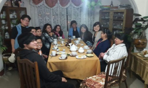 Katie Souris has tea with a focus group in Bolivia.
