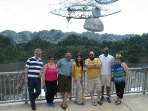 Deytia visits the Arecibo radio telescope in Puerto Rico with friends.