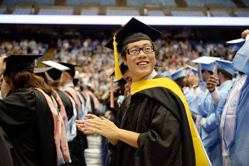 Graduates celebrate after turning tassels during commencement.