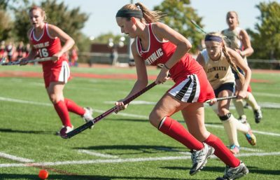 Taylor rushes toward the goal during a college field hockey match. (Contribute photo)