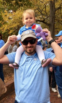 John and his daughter cheer on the Tar Heels.