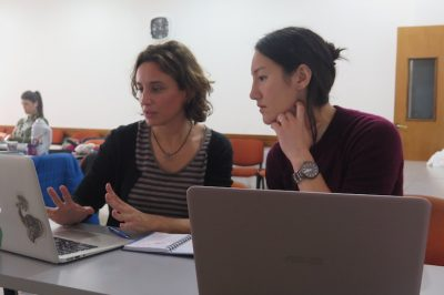 Caitlin, at right, works with a colleague to build a sex ed app.