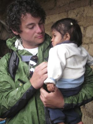 Andrew holds a severely malnourished girl he met in rural Guatemala. To him, she represents completely unnecessary suffering that, for a low cost, can be eliminated.