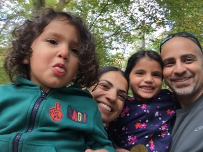Dr. Raz Shaikh hikes with his family in Umstead State Park.