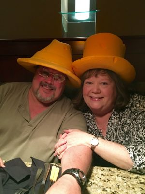 "Angie smiles with her husband, Jon. In her words: ""We were at the Melting Pot having fondue, so of course we had to be cheeseheads!"" (Contributed photo)"