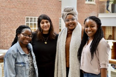 From left to right: Deanie, Ishani, Hailey and Rakiah smile together.