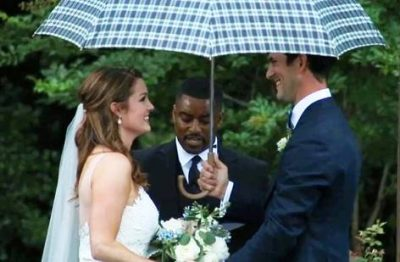 Matt and his wife share wedding vows during a storm.