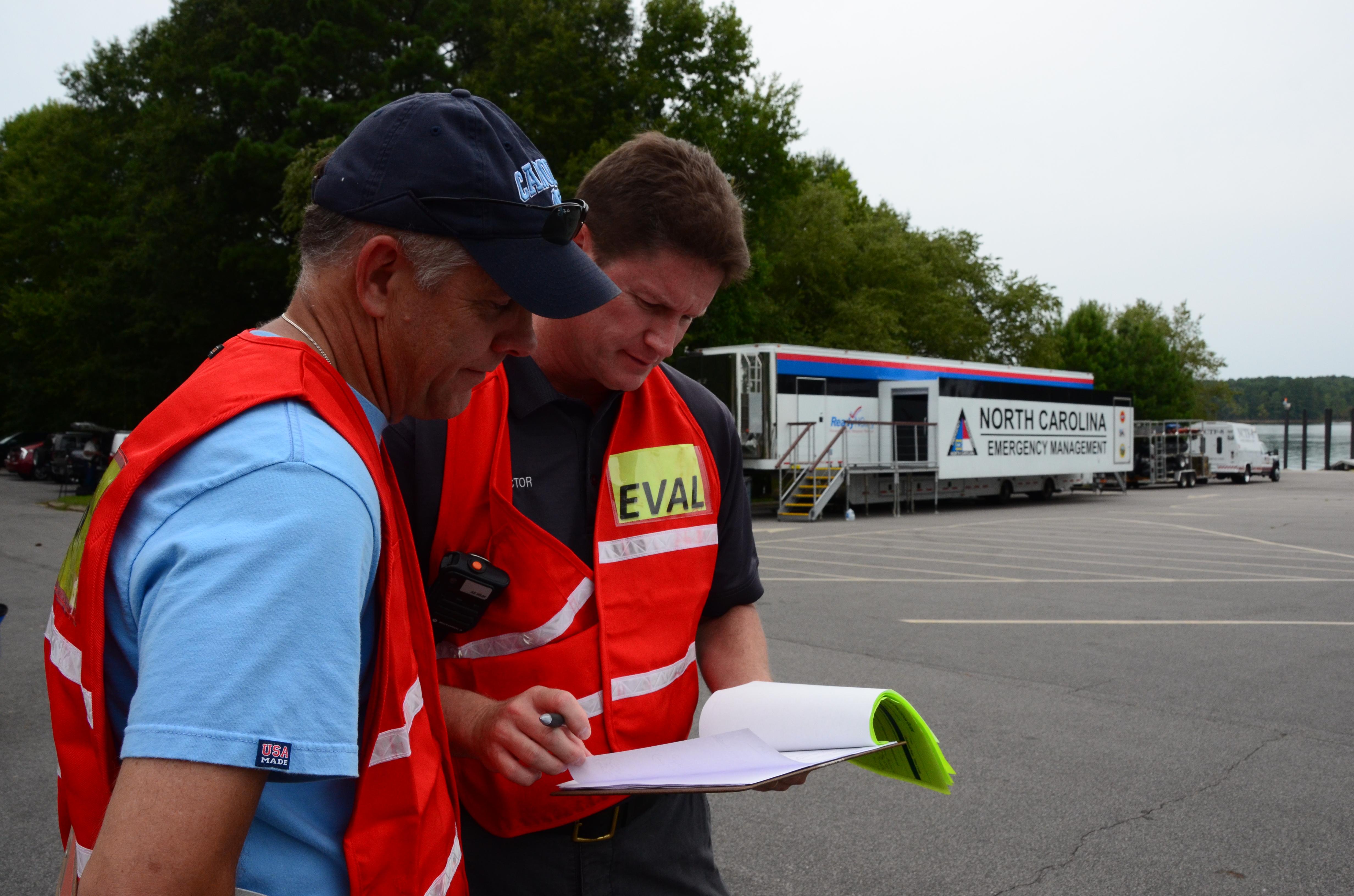 Bill Gentry (left), MPA, evaluates a community-preparedness operation.