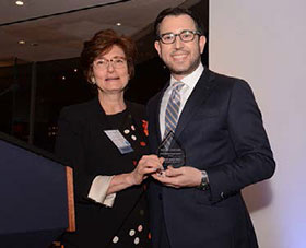 Dr. Benjamin Meier, right, accepts an outstanding alumnus award from Dean Linda Fried, of Columbia University's Mailman School of Public Health.