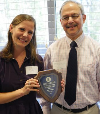 Anna Freeman, BSN, MPH '11, accepts the Sidney S. Chipman Award from Associate Professor Lew Margolis, MD, MPH.