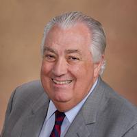 Dr. Emlyn Koster