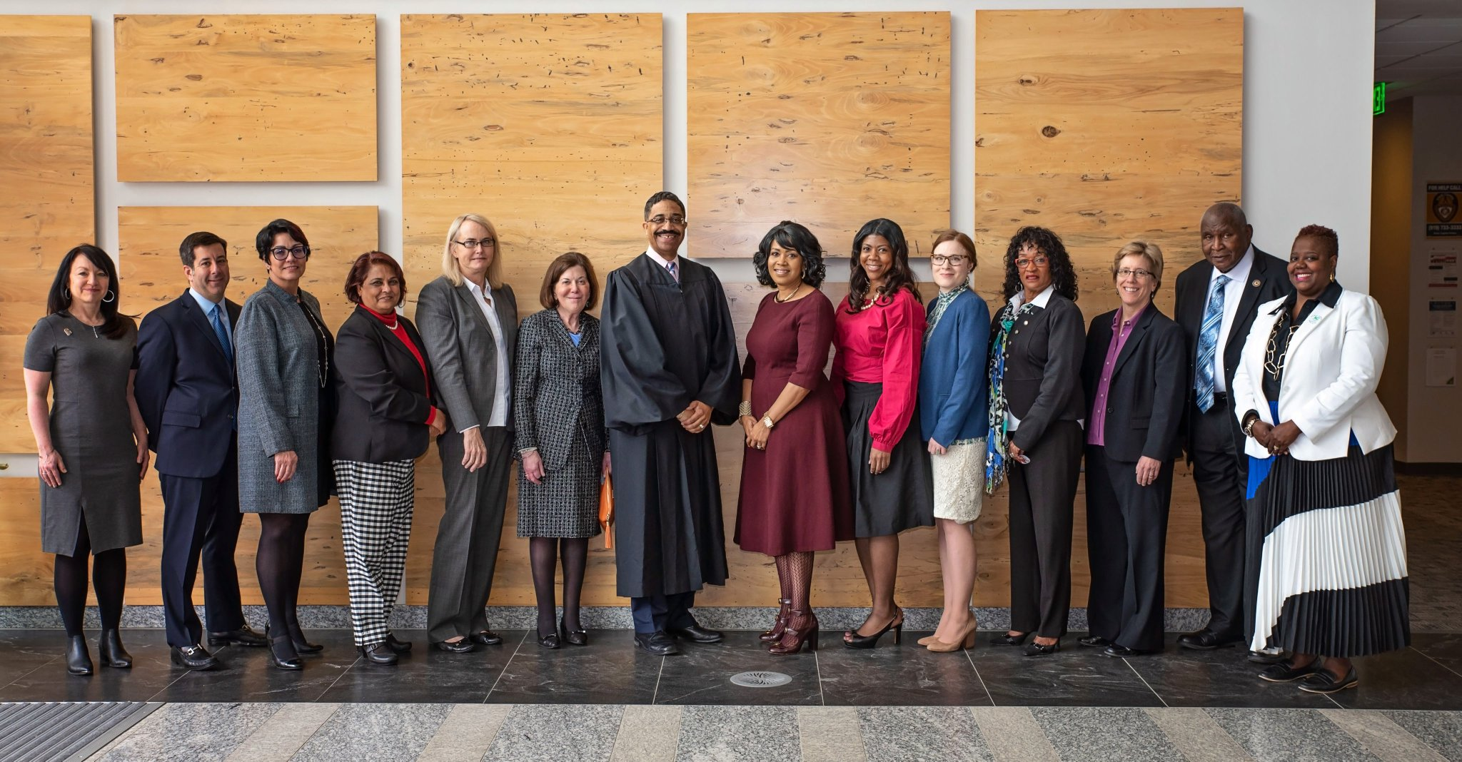 Dean Rimer (sixth from left) stands with other members of the Commission on Inclusion.