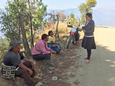 Taylor (standing) interviews community members in Guatemala to determine their water and health needs. (Contributed photo)
