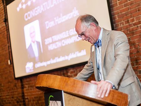 Don Holzworth speaks to attendees at a meeting of the Triangle Global Health Consortium on May 2. The group presented Holzworth with its 2018 Global Health Champion award. Photo by Kelley Bennett Photography.
