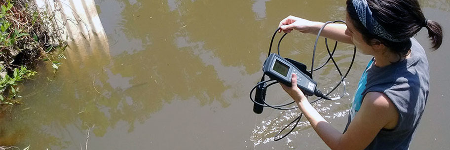 Doctoral student Elizabeth Christenson tests the water quality in a local lake. As a Boren Fellowship awardee in 2018-2019, Christenson will use her scientific training to work on community-based public health and disease prevention initiatives in the Middle East.