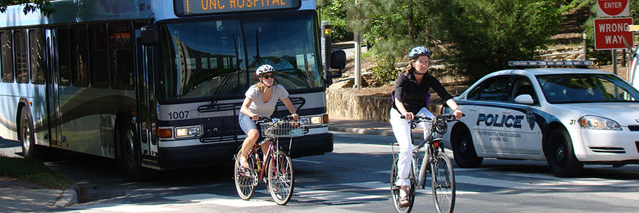 Two Chapel Hill residents ride their bikes through campus.