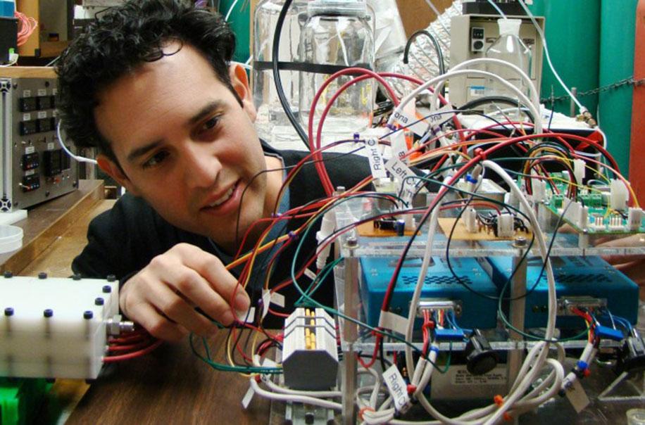 Dr. Vizuete works on smog machine equipment.