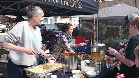 Dr. Ammerman serves her heart-healthy vegetarian chili at a community event in eastern North Carolina.