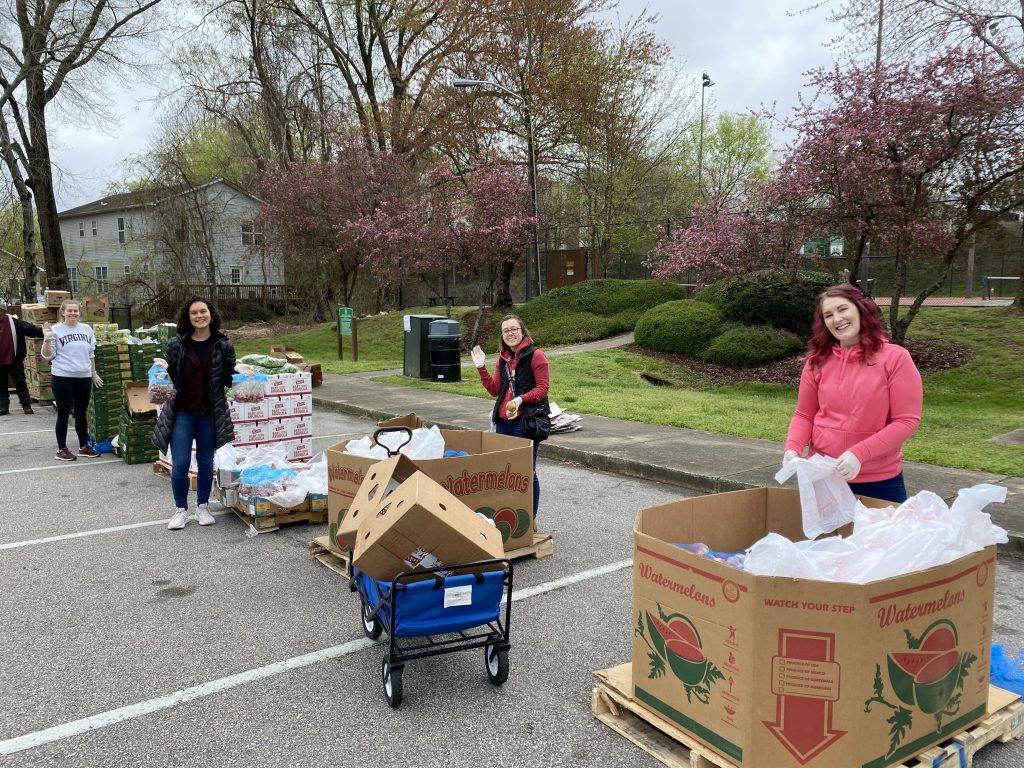 MPH students Allie Atkeson and Laura Powis, first-year MCFH student Emily Howe, and recent MCH graduate Kathleen Shumaker volunteered with PORCH to assist with food distribution.
