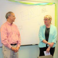 Chair of MCH, Dr. Carolyn Halpern congratulates Dr. Margolis on his successful career.
