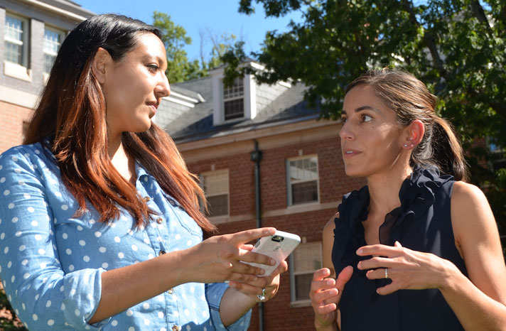 Dr. Aiello (right) discusses an app with a student.
