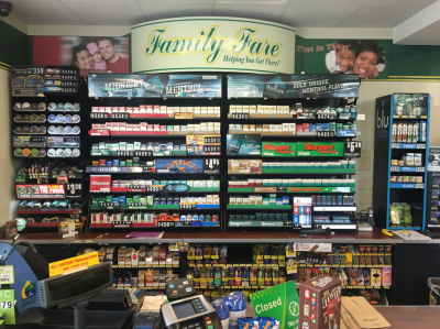 Tobacco products line the shelves at a typical small retail store.