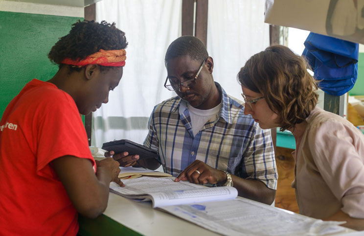 Hayley Welgus (far right) works with Save the Children colleagues in Haiti.