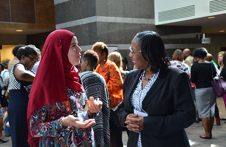 Minority Health Conference attendees stop to chat.