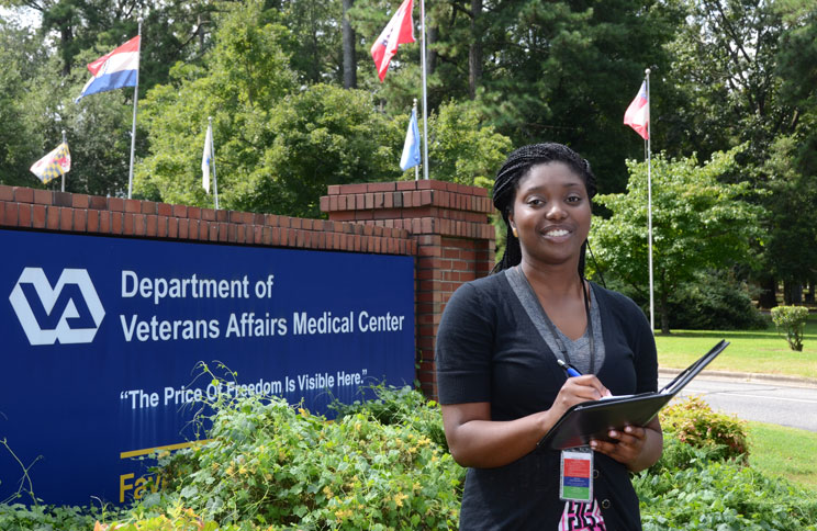 A student visits the VA to provide a survey.