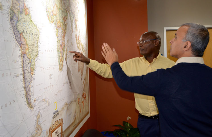 Two clinicians study a map.