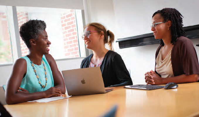 Program co-leaders Drs. Courtney Woods, Asia Maselko and Anissa Vines (left to right) meet to discuss plans for the Equity concentration, one of the 12 new specialized fields of study within the Gillings School's Master of Public Health degree.