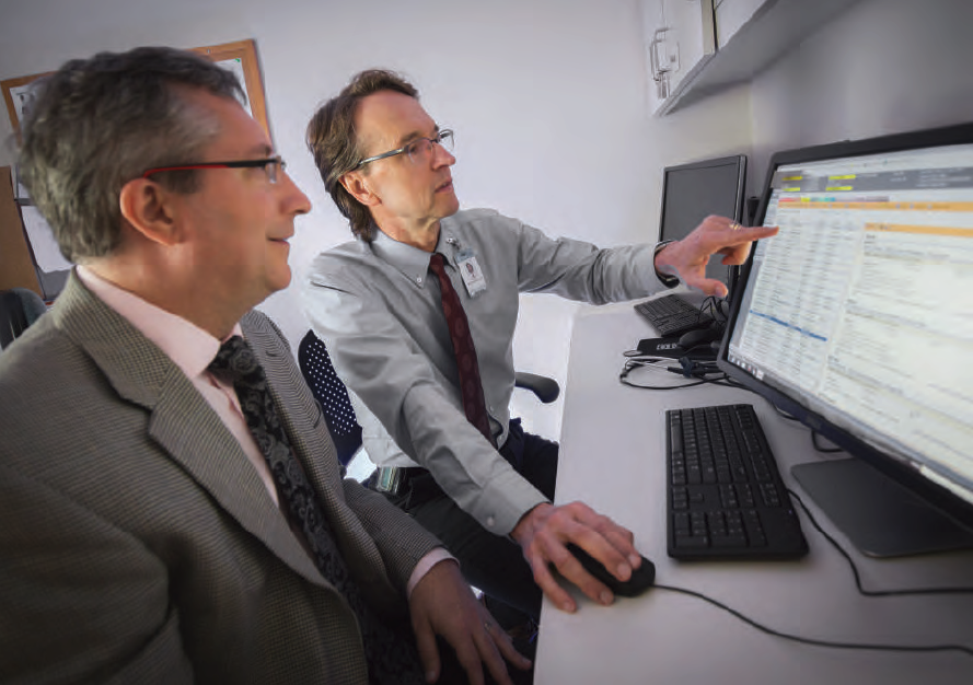 Dr. Michael Kosorok (foreground) discusses precision medicine strategies with Dr. George Retsch-Bogart, a pediatric pulmonologist at the UNC School of Medicine. Precision medicine is one application of data science and machine learning methods that are the focus of the new Public Health Data Science concentration.