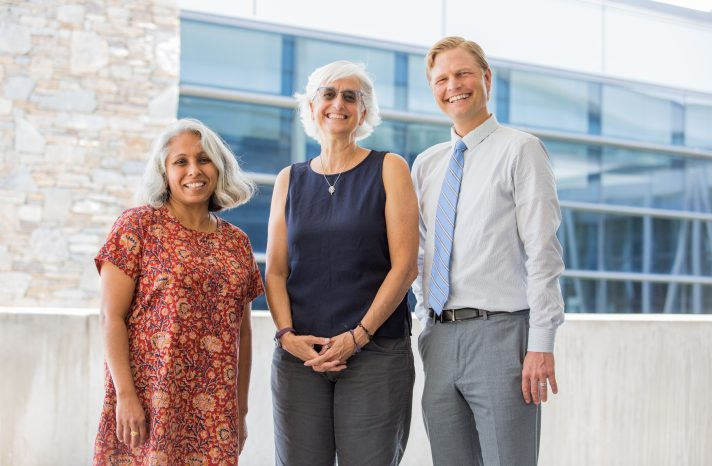 Dr. Travis Johnson (right), interim director of the Asheville MPH program, poses with Drs. Ameena Batada (left) and Amy Lanou, consultants and instructors in the program.