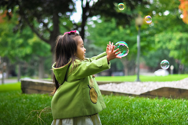 Toddler girl with bubbles
