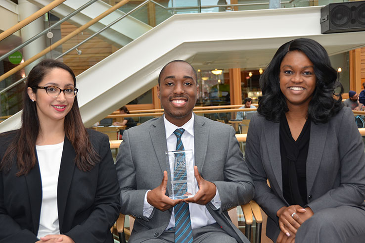 Whitney Okie, Ruben Joseph and Gina Thompson, pose with their award.