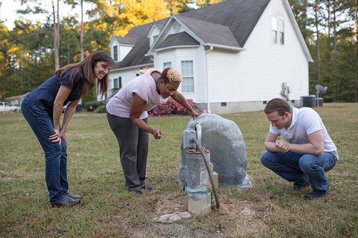 Dr. Jackie Gibson and student Frank Stillo examine a homeowner's well.