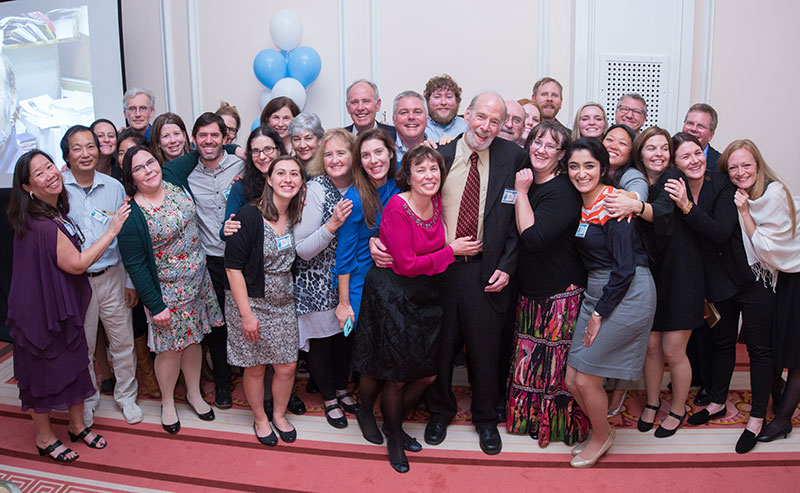 Dr. Mark Sobsey (in tie, just right of center) celebrates with friends, family members, colleagues and former students at his retirement event on Nov. 30.