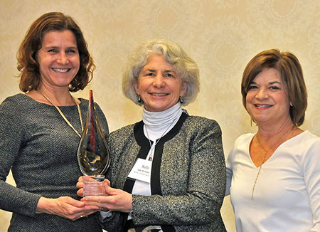 Sally Herndon, center, accepts the Levine Award at the 2019 N.C. Public Health Leaders' Conference, held Jan. 24-25 in Raleigh.
