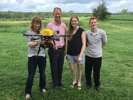 AED-Drone Project team members (l-r) Dr. Jessica Zègre-Hemsey, co-investigator, Dr. Wayne Rosamond, Brittany Bogle and Chris Cunningham conducted a drone test recently at N.C. State University.