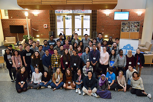 Attendees of the 2019 Community Empowerment Fund Summit on Homelessness and Poverty pose at the UNC Gillings School during the event, which was held March 1-3. Photo by Ziola Kowzan.