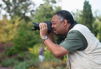 Dr. Paul Godley captures a photograph.