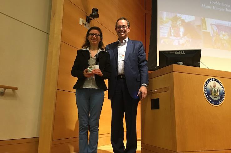Jessica Soldavini (left) accepts the 2019 Rise Against Hunger World Hunger Leadership Award.