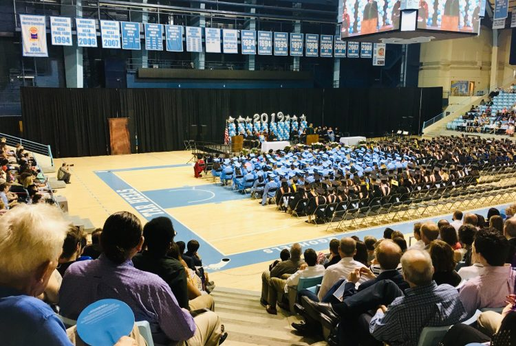 Graduates, along with friends and family, gather in the Carmichael Arena for the 2019 Gillings School commencement.