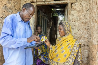 Shaabani Khamis visits the home of malaria patient Siti Haji Nassor, 14, to test her mother for malaria, check on medication, and follow up using an electronic system. (Photo credit: U.S. President's Malaria Initiative)